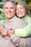 Happy elderly couple. In love in park Royalty Free Stock Image