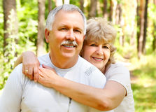 Happy elderly couple. Smiling happy  elderly couple in love outdoor Royalty Free Stock Photos