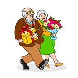 Happy elderly couple with a bouquet of flowers and a gift. Funny Stock Photography
