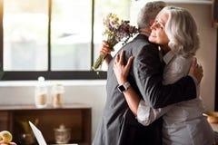 Happy elderly couple celebrating wedding anniversary stock photo