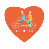 Happy elderly couple cycling bicycle together.  anniversary for grandparent. Royalty Free Stock Photography
