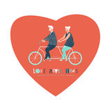 Happy elderly couple cycling bicycle together.  anniversary for grandparent. Royalty Free Stock Photo