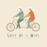 Happy elderly couple cycling bicycle together.  anniversary for grandparent. Stock Photos