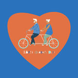 Happy elderly couple cycling bicycle together. Happy anniversary for grandparent. Happy valentines day card  Stock Photo