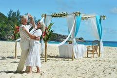 Happy elderly couple dancing stock images