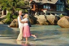 Couple dancing on beach Stock Photo
