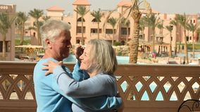 Happy elderly couple dancing. On the terrace stock video footage