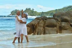 Couple  dancing  on  tropical beach. Happy elderly  couple  dancing  on  tropical beach Stock Photography