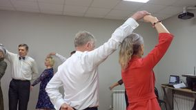 Happy elderly couple dancing waltz in dance club. Mature man and woman performing waltz at dance event in entertainment. Club. Senior people activity stock video footage