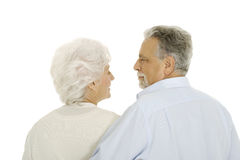 Happy elderly couple embraced from behind Stock Photo