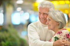 Happy elderly couple embracing Stock Images
