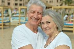 Happy elderly couple embracing Stock Photography