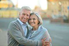 Happy elderly couple embracing royalty free stock photo