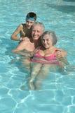 Happy Elderly couple with grandson Stock Image