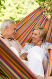 Happy elderly couple in hammock Stock Image