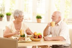 Happy elderly couple having breakfast Stock Photography