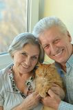 Happy elderly couple at home Stock Images