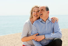Happy elderly couple hugging outdoor Royalty Free Stock Photography