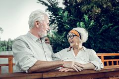 Happy elderly couple lovingly looking at each other royalty free stock photos
