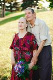 Happy elderly couple at nature. Happy old people stock photography