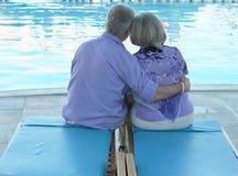 Happy Elderly couple near pool Stock Photos