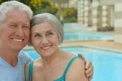 Happy Elderly couple near pool Royalty Free Stock Photos