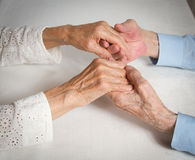 Happy elderly couple. Old people holding hands. Royalty Free Stock Photo