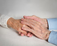 Happy elderly couple. Old people holding hands. Stock Image