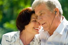 Happy elderly couple, outdoors Stock Photos