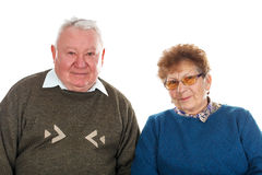 Happy elderly couple. Picture of a happy elderly couple posing on an isolated background Royalty Free Stock Image