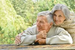 Happy elderly couple. Portrait of a a happy elderly couple in autumn park Royalty Free Stock Photo