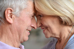 Elderly couple in the room Royalty Free Stock Image