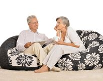 Happy elderly couple resting at home Royalty Free Stock Image