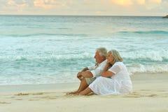 Happy elderly couple resting stock photos