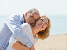 Happy elderly couple at sea vacation smiling and hug Royalty Free Stock Photo