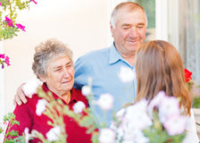 Happy elderly couple. Talking with the therapist Royalty Free Stock Images