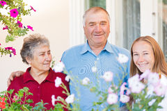 Happy elderly couple. The happy elderly couple with their caregiver Stock Photography