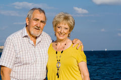 Happy elderly couple on vacation. Happy smiling seniors on vacation Stock Photos