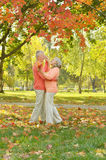 Happy elderly couple. Walking in autumn park Stock Photography
