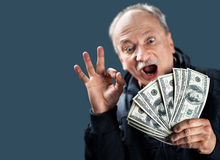 Happy elderly with fan of money Stock Photography
