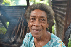 Happy elderly indigenous Fijian woman. In her 70`s smile. According to 2015 WHO data, The life expectancy in Fiji is: Male 67, female 73 and total life Stock Photo