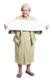 Happy elderly lady holding blank sheet in hands Stock Image