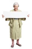 Happy elderly lady holding blank sheet in hands Royalty Free Stock Photos