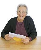 Happy, elderly lady with letter Stock Photography
