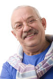 The happy elderly man. Portrait on a white background, smiling elderly man in glasses Royalty Free Stock Images