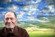 The happy elderly man against the sunset sky Royalty Free Stock Photos