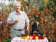 Happy elderly man with crops Stock Photo