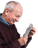 Happy elderly man with dollars Royalty Free Stock Image