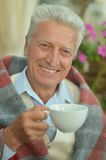 Happy elderly man drinking tea Royalty Free Stock Photography