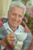 Happy elderly man drinking tea Royalty Free Stock Photography